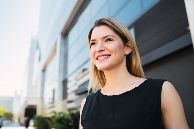 Business woman standing outside office buildings. Premium Photo