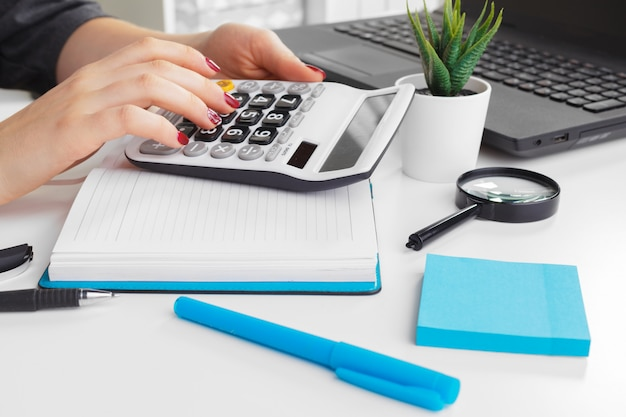Business woman working with financial data hand using calculator Premium Photo