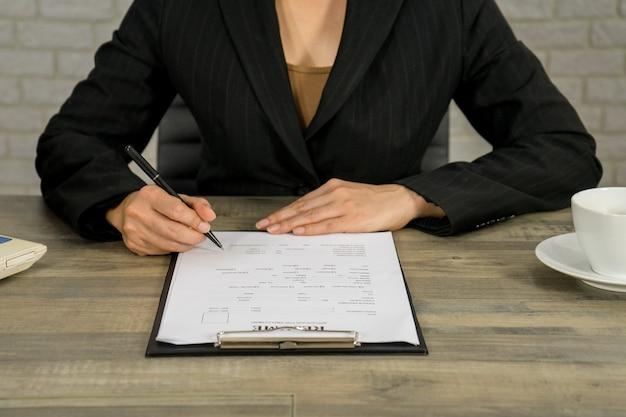 Business woman write resume for applying the job Premium Photo