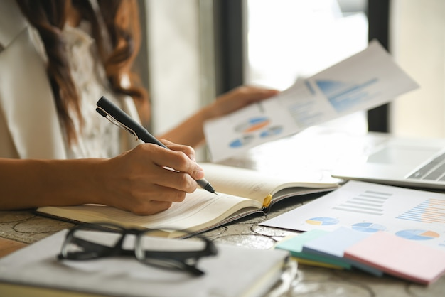 Business women are checking the company performance chart. Premium Photo