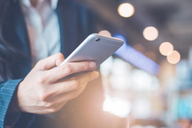Business women hand are using smartphone. Premium Photo