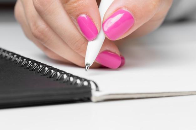 Business women hands writing notebook Premium Photo