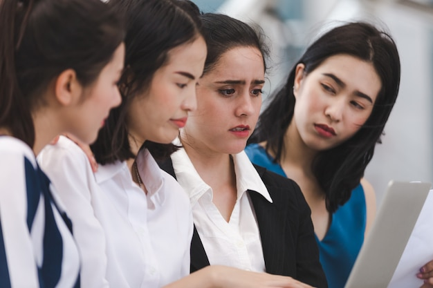 Business women team with serious tired depressed unemployed outdoor Premium Photo