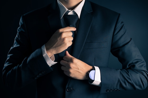 Businessman adjust necktie his suit Premium Photo