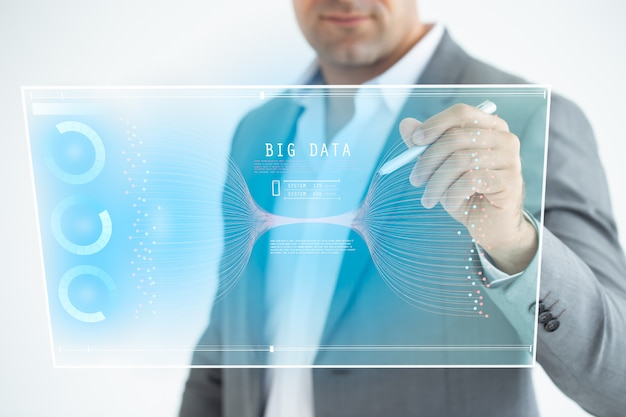 Businessman analysis on digital screen, technological digital futuristic virtual interface, business strategy and big data. Premium Photo