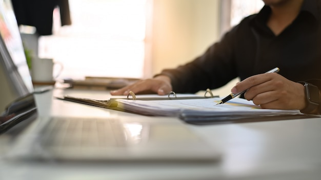 Businessman analysis on document paper with cropped shot. Premium Photo