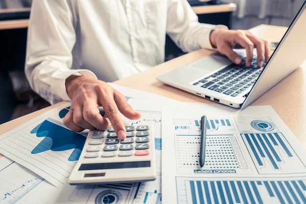 Businessman analyze data of stock market research. Premium Photo