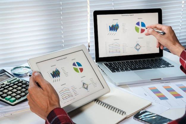 Businessman analyzing financial figures denoting the progress in the work of the company Premium Photo