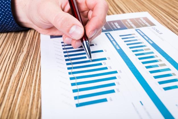 Businessman analyzing investment charts Premium Photo