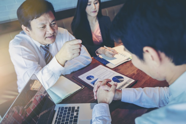 Businessman as boss blaming his employee for business mistake while business meeting in office Premium Photo