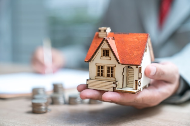 Businessman as a property agent or investor calculating growth of return Premium Photo