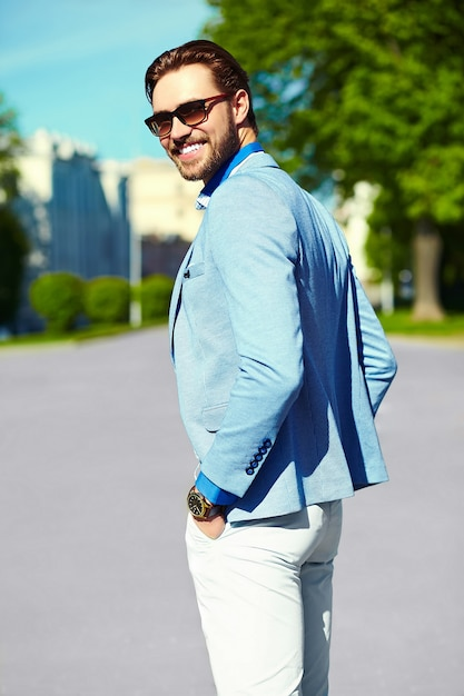 Businessman in blue suit wearing sunglasses in the street ...