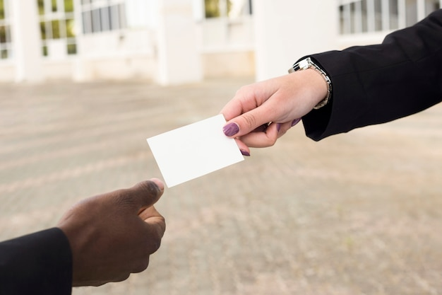 Businessman and businesswoman exchanging business card Free Photo