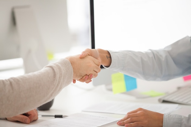 Businessman and businesswoman handshaking after signing contract or successful negotiation Free Photo