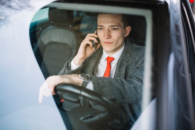 Businessman calling Free Photo