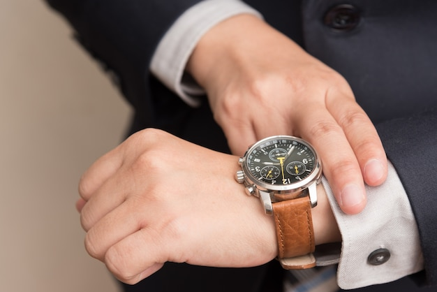 Businessman checking the time Free Photo