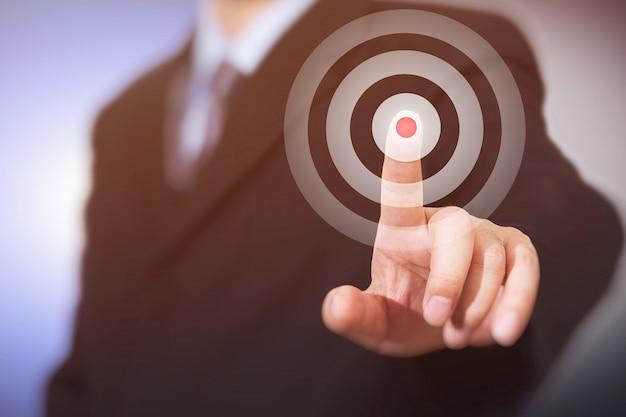 Businessman click on target. Premium Photo