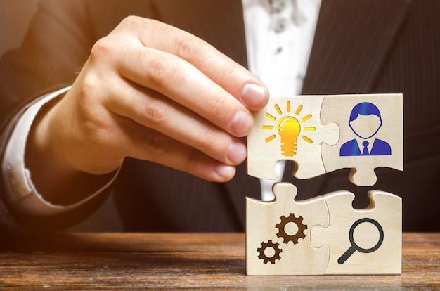 Businessman collects puzzles Premium Photo