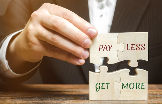 Businessman collects wooden puzzles Premium Photo