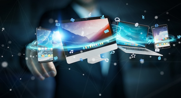 Businessman connecting tech devices and icons applications Premium Photo