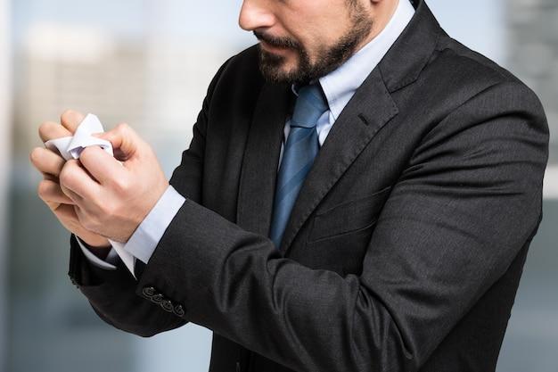 Businessman crumpling a document in his office Premium Photo