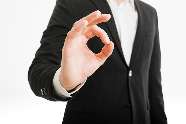 Businessman doing ok gesture Free Photo
