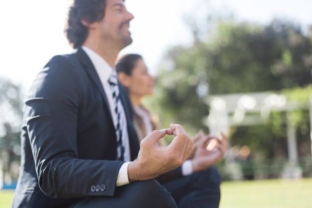 Businessman doing relaxation exercises Free Photo