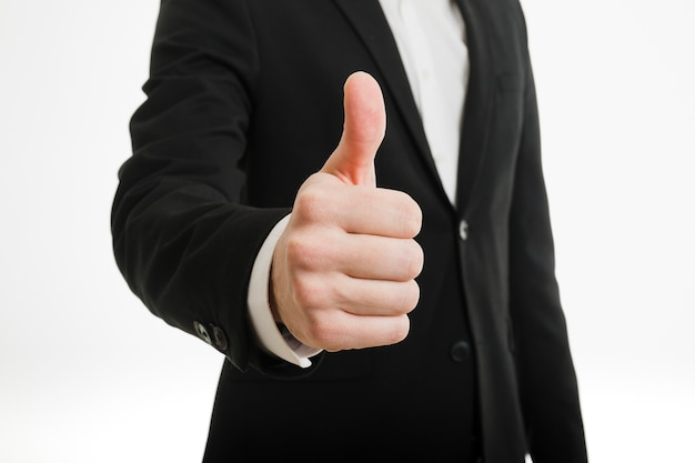 Businessman doing thumbs up gesture Free Photo