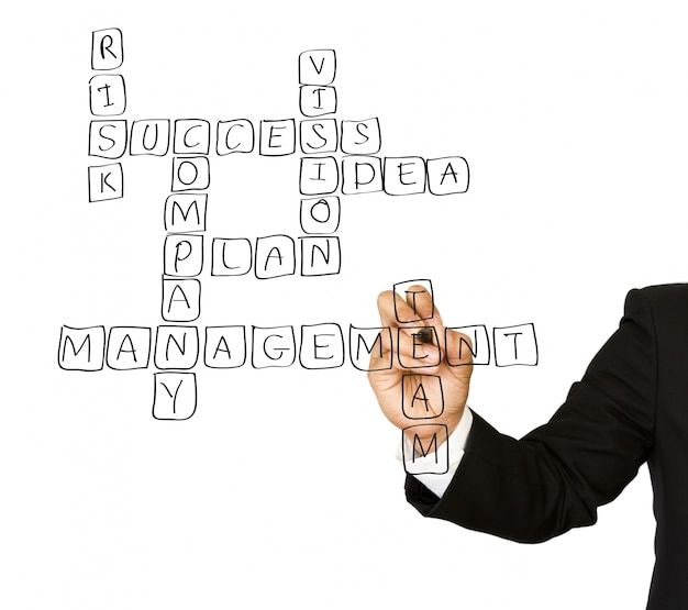 Businessman drawing a crossword Free Photo