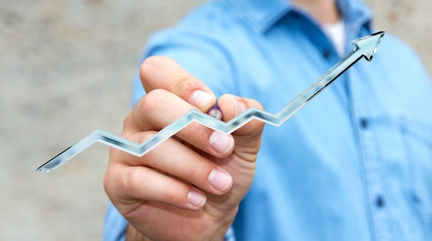 Businessman drawing digital blue arrow with a pen Premium Photo
