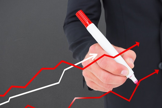 Businessman drawing lines with a marker Free Photo