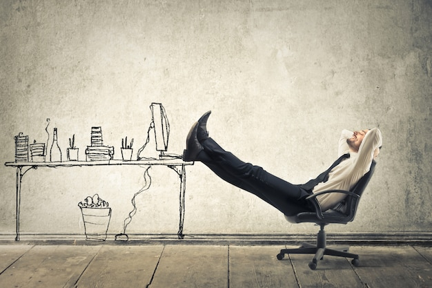 Businessman dreaming of an office Premium Photo