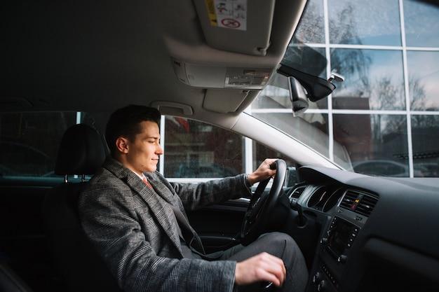 Businessman driving Free Photo