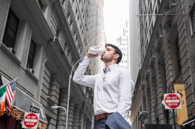 Businessman enjoying hot beverage Free Photo