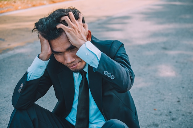 Businessman fail work and business,business people sit stressful and headache Premium Photo