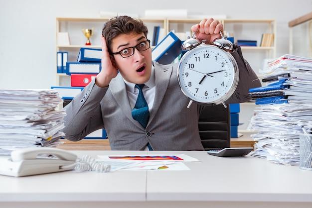 Businessman failing to meet tough deadline Premium Photo