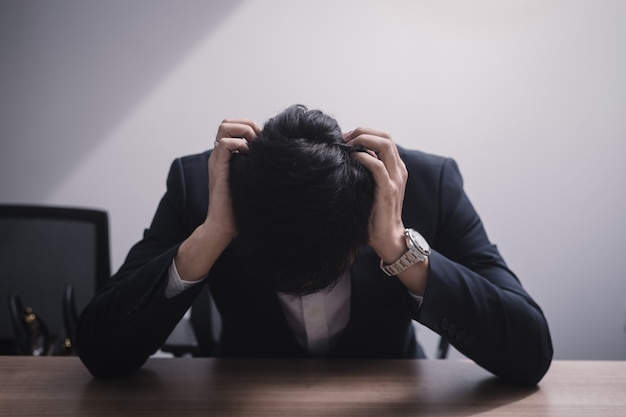 Businessman failing and serious in office Premium Photo
