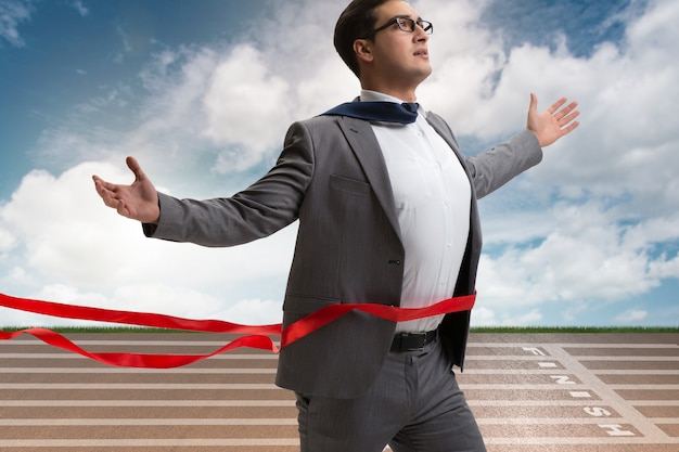 Businessman on the finishing line in competition concept Premium Photo