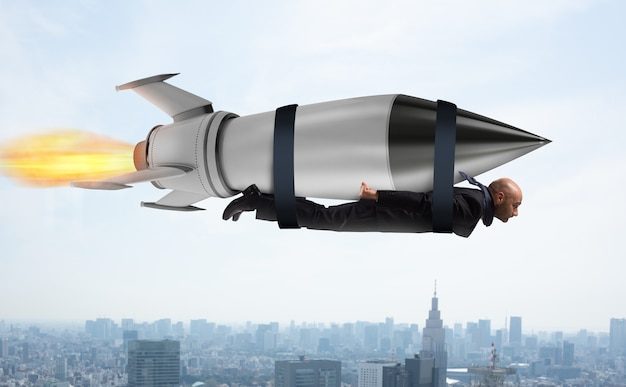 Businessman flies with a fast rocket. concept of ambition and determination Premium Photo