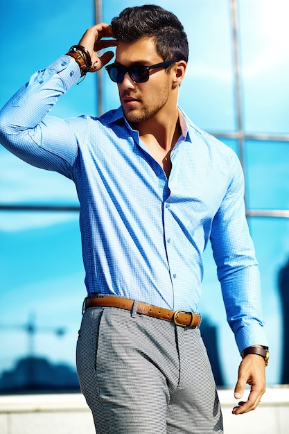 Businessman in formal clothes and sunglasses Free Photo