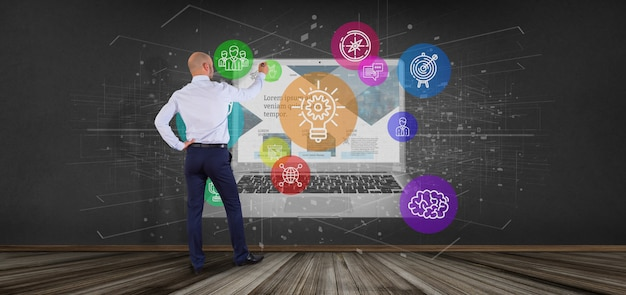 Businessman in front of a cloud of colorfull start up icon bubble with a laptop 3d rendering Premium Photo
