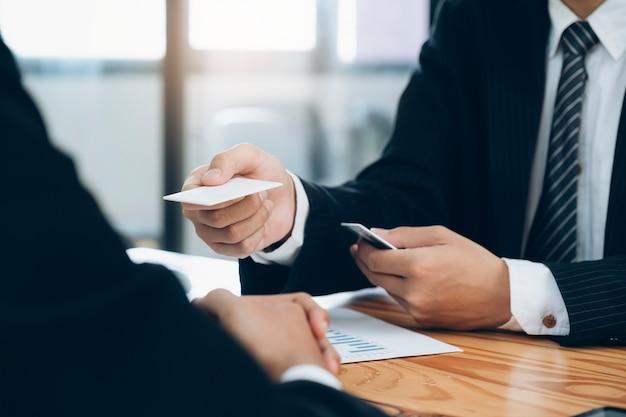 Businessman giving a business card. Premium Photo