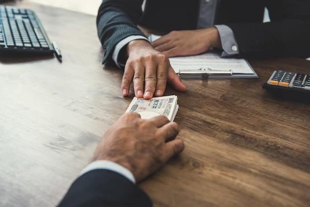 Businessman giving money Premium Photo