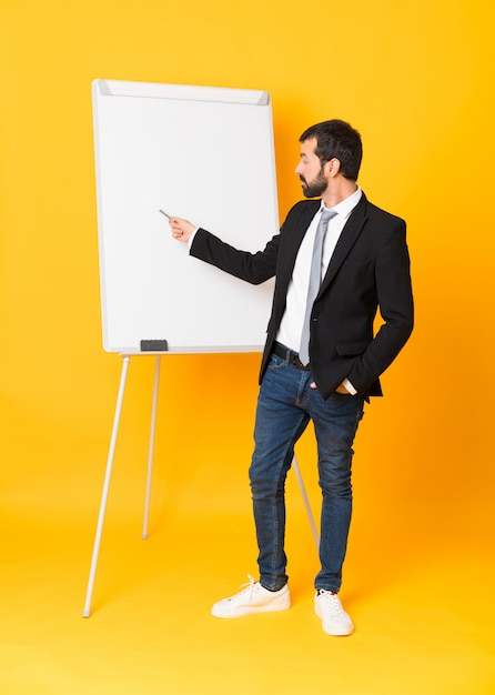 Businessman giving a presentation on white board Premium Photo