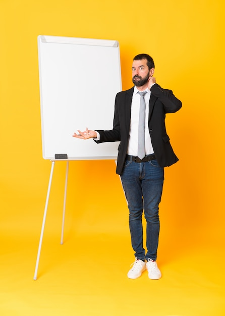 Businessman giving a presentation on white board Premium Photo