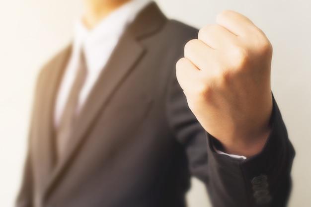 Businessman hand showing fist sign gesture Premium Photo