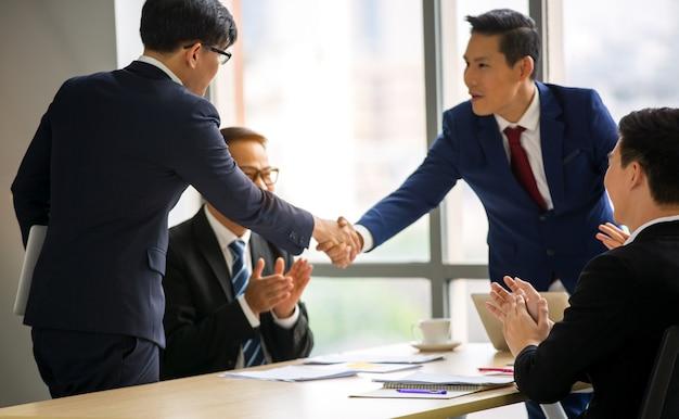 Businessman handshake in meeting Premium Photo