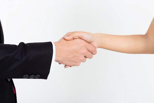 Businessman handshake with young secretary woman on white Free Photo