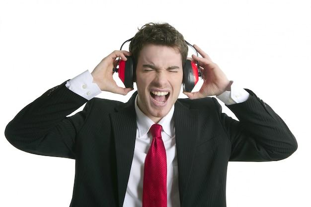 Businessman headphones noise expression gesture Premium Photo