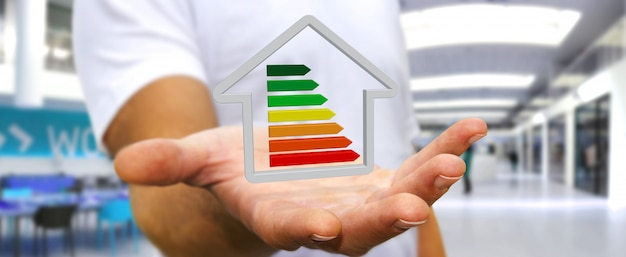 Businessman holding 3d eco house and energy efficiency Premium Photo